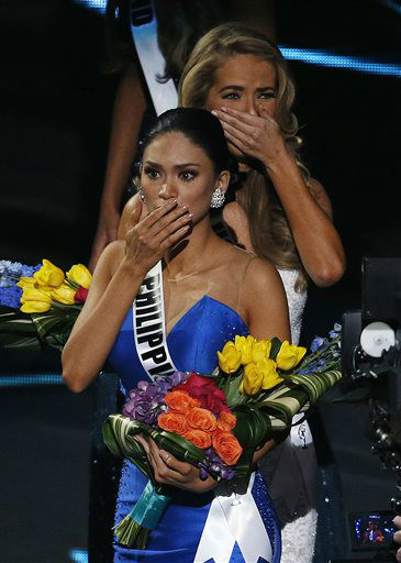 "<div class=""meta image-caption""><div class=""origin-logo origin-image none""><span>none</span></div><span class=""caption-text"">Miss Philippines Pia Alonzo Wurtzbach, front, reacts after she was announced as the new Miss Universe (AP Photo/ John Locher)</span></div>"