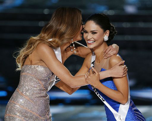 <div class='meta'><div class='origin-logo' data-origin='none'></div><span class='caption-text' data-credit='AP Photo/ John Locher'>Miss Colombia Ariadna Gutierrez, left, and Miss Philippines Pia Alonzo Wurtzbach react as they make the final three</span></div>