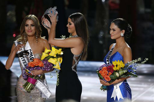 <div class='meta'><div class='origin-logo' data-origin='none'></div><span class='caption-text' data-credit='AP Photo/ John Locher'>Former Miss Universe Paulina Vega, center, removes the crown from Miss Colombia Ariadna Gutierrez.</span></div>