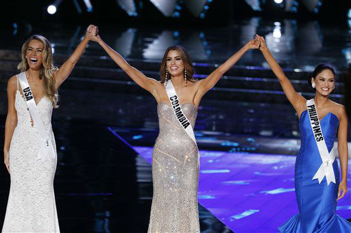 "<div class=""meta image-caption""><div class=""origin-logo origin-image none""><span>none</span></div><span class=""caption-text"">From left, Miss USA Olivia Jordan, Miss Colombia Ariadna Gutierrez and Miss Philippines Pia Alonzo Wurtzbach react as they make the final three (AP Photo/ John Locher)</span></div>"