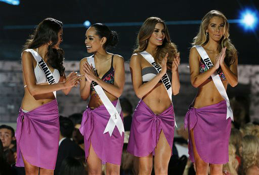<div class='meta'><div class='origin-logo' data-origin='none'></div><span class='caption-text' data-credit='AP Photo/ John Locher'>From left, Miss Thailand Aniporn Chalermburanawong, Miss Japan Ariana Miyamoto, Miss Colombia Ariadna Gutierrez and Miss USA Olivia Jordan</span></div>