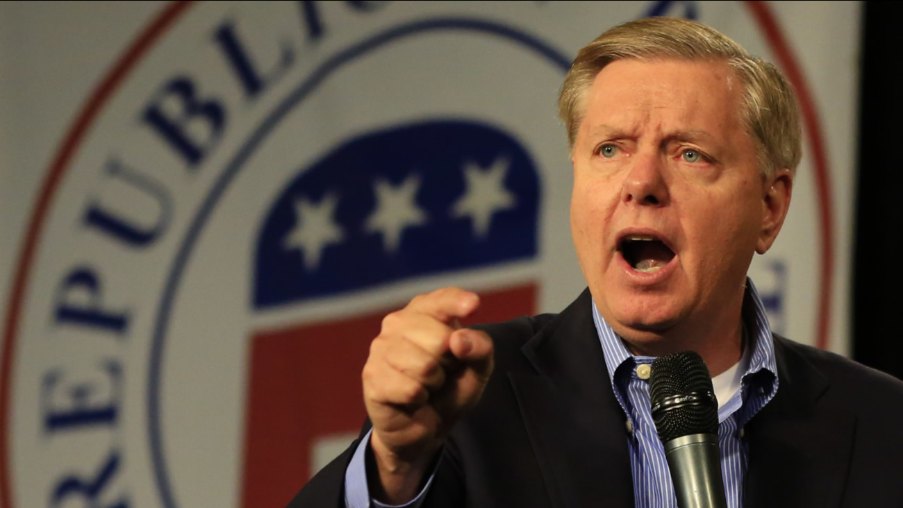 FILE: Republican presidential candidate, Sen. Lindsey Graham, R-S.C., speaks at the Iowa GOP's Growth and Opportunity Party at the Iowa state fair grounds in Des Moines, Iowa.