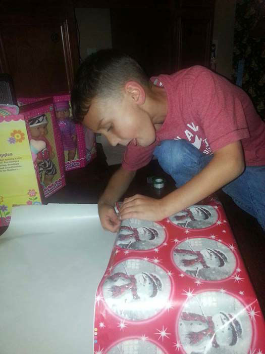 "<div class=""meta image-caption""><div class=""origin-logo origin-image none""><span>none</span></div><span class=""caption-text"">Jacob wrapped the presents for the children before delivering the gifts (KTRK Photo/ Family photo/Janie Morris)</span></div>"
