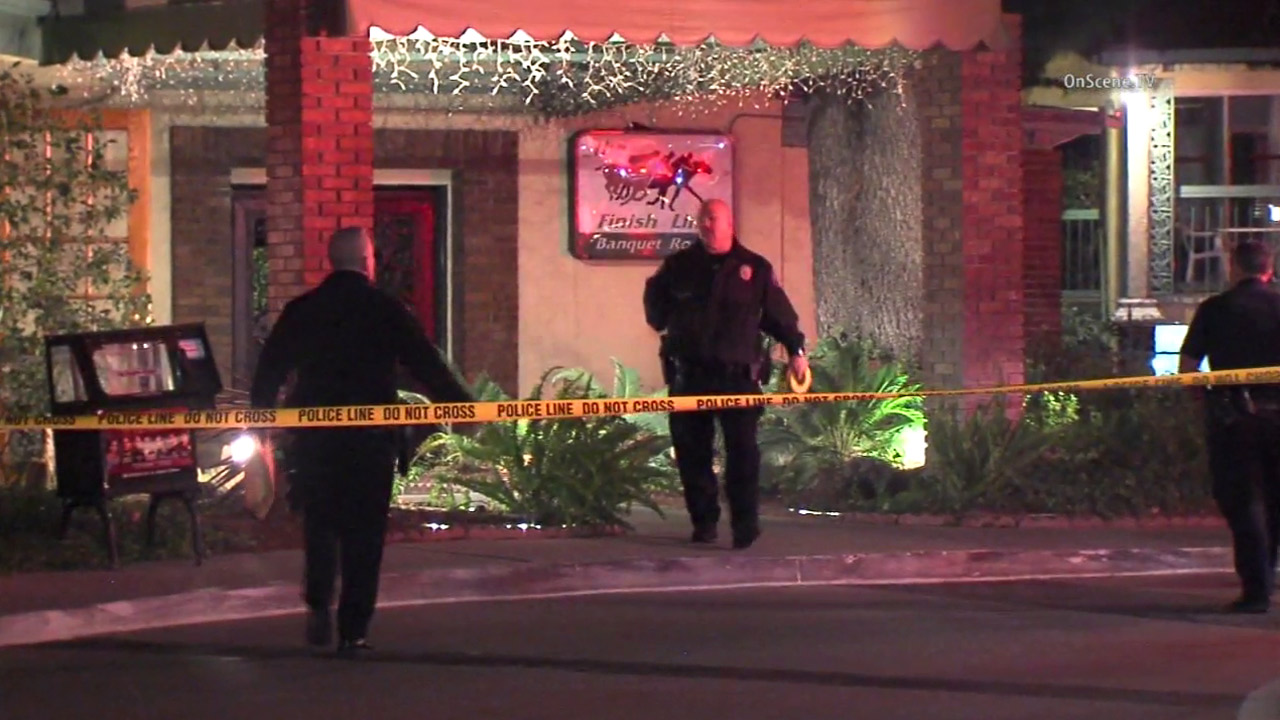 Authorities cordoned off an area at an Arcadia motel after an armed robbery suspect made off with money on Monday, Dec. 21, 2015.
