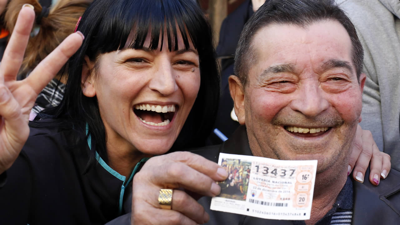 "Winners of a Spain lottery celebrate the first Christmas lottery prize ""El Gordo"" (""The Fat One"") in La Eliana, near Valencia, eastern Spain, Spain, Dec. 22, 2014. (AP Photo)"