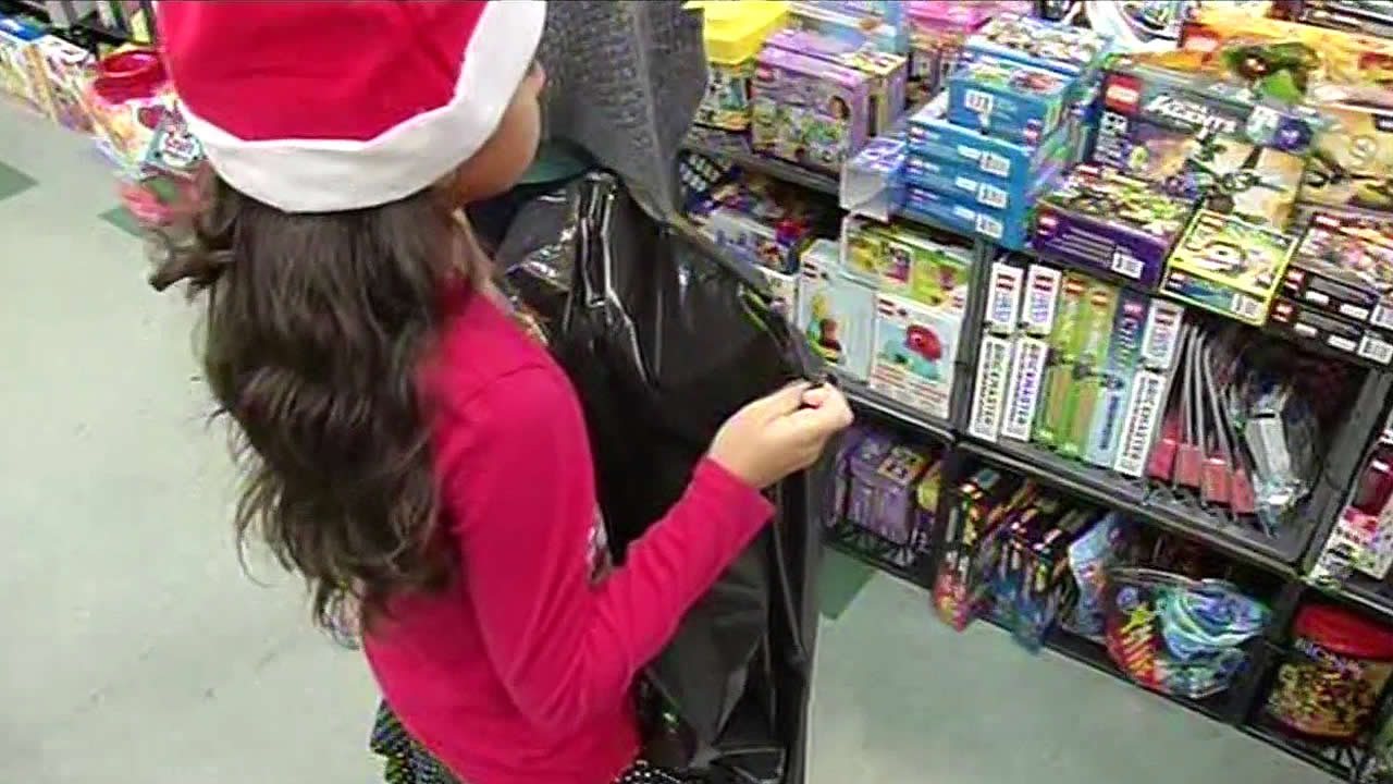 A girl is seen at Sacred Heart Community Service's toy giveaway in San Jose, Calif. on December 22, 2015.