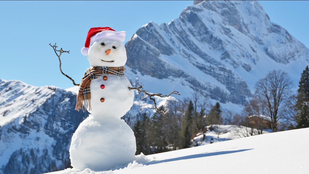A snowman on a mountain.