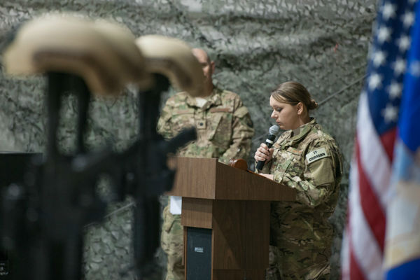 """<div class=""""meta image-caption""""><div class=""""origin-logo origin-image none""""><span>none</span></div><span class=""""caption-text"""">Service members from several units at Bagram Air Field, Afghanistan, pay their respects during a fallen comrade ceremony held in honor of six Airmen Dec. 23, 2015. (Photo/Tech. Sgt. Robert Cloys)</span></div>"""