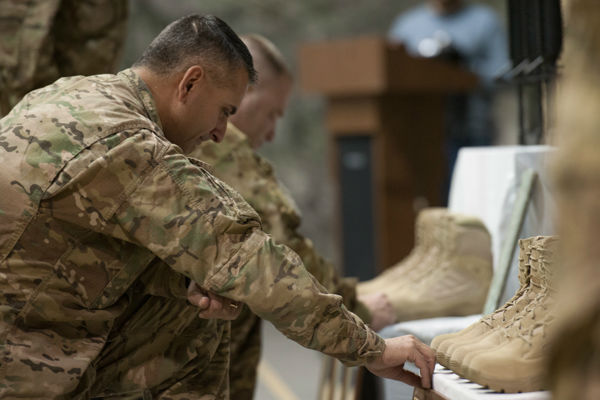 "<div class=""meta image-caption""><div class=""origin-logo origin-image none""><span>none</span></div><span class=""caption-text"">Brig. Gen. David Julazadeh, 455th Air Expeditionary Wing commander, pays his respects during a fallen comrade ceremony at Bagram Air Field, Afghanistan, Dec. 23, 2015. (Photo/Tech. Sgt. Robert Cloys)</span></div>"