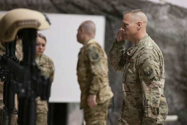 "<div class=""meta image-caption""><div class=""origin-logo origin-image none""><span>none</span></div><span class=""caption-text"">Chief Master Sgt. Matt Grengs, 455th Air Expeditionary Wing command chief, pays his respects during a fallen comrade ceremony at Bagram Air Field, Afghanistan, Dec. 23, 2015. (Photo/Tech. Sgt. Robert Cloys)</span></div>"