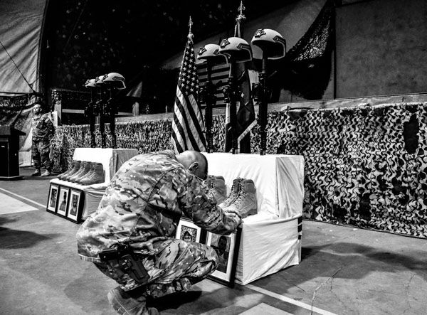 "<div class=""meta image-caption""><div class=""origin-logo origin-image none""><span>none</span></div><span class=""caption-text"">Chief Master Sgt. Matt Grengs, 455th Air Expeditionary Wing command chief, pays his respects during a fallen comrade ceremony at Bagram Air Field, Afghanistan, Dec. 23, 2015. (Photo/Tech. Sgt. Nicholas Rau)</span></div>"