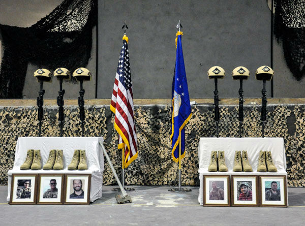"""<div class=""""meta image-caption""""><div class=""""origin-logo origin-image none""""><span>none</span></div><span class=""""caption-text"""">Service members from several units at Bagram Air Field, Afghanistan, pay their respects during a fallen comrade ceremony held in honor of six Airmen Dec. 23, 2015. (Photo/Tech. Sgt. Nicholas Rau)</span></div>"""