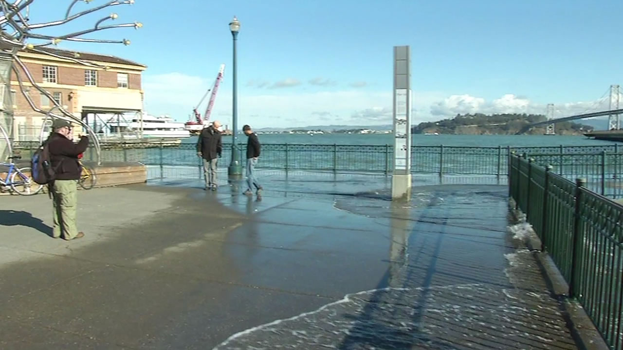 water on the Embarcadero lapping up over the piers due to king tides