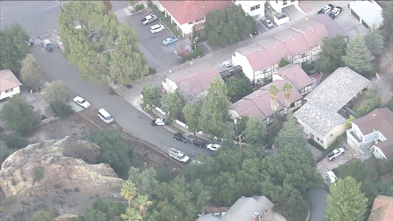 Los Angeles sheriff's deputies respond to reports of an armed barricaded man at an apartment complex in Agoura Hills on Wednesday, Dec. 23, 2015.
