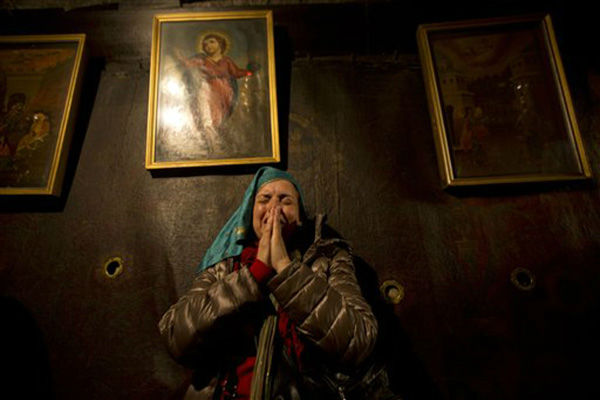 "<div class=""meta image-caption""><div class=""origin-logo origin-image none""><span>none</span></div><span class=""caption-text"">Christian pilgrims pray inside the Grotto of the Church of Nativity, traditionally believed by Christians to be the birthplace of Jesus Christon Christmas Eve 2015. (AP Photo/ Majdi Mohammed)</span></div>"
