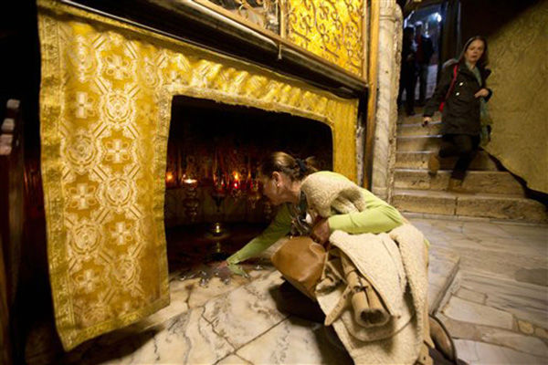"<div class=""meta image-caption""><div class=""origin-logo origin-image none""><span>none</span></div><span class=""caption-text"">A Christian worshiper touches the silver star which marks the place where Jesus Christ was born in the Grotto at the Church of the Nativity on Dec. 23, 2015. (AP Photo/ Majdi Mohammed)</span></div>"