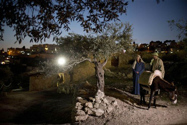 "<div class=""meta image-caption""><div class=""origin-logo origin-image none""><span>none</span></div><span class=""caption-text"">Christian actors portray Joseph and Mary during a re-enactment of a Nativity scene of the journey to Bethlehem in the northern Israeli city of Nazareth, Tuesday, Dec. 22, 2015. (AP Photo/ Ariel Schalit)</span></div>"