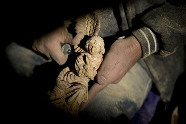 "<div class=""meta image-caption""><div class=""origin-logo origin-image none""><span>none</span></div><span class=""caption-text"">A Palestinian wood carver works on a figurine of an angel at an olive wood factory next to the Church of the Nativity in the West Bank city of Bethlehem. (AP Photo/ Majdi Mohammed)</span></div>"