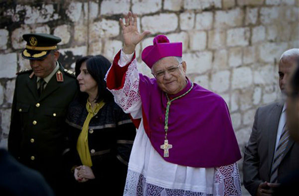 "<div class=""meta image-caption""><div class=""origin-logo origin-image none""><span>none</span></div><span class=""caption-text"">Latin Patriarch of Jerusalem Fouad Twal, center, arrives at the Church of the Nativity, built atop the site where Christians believe Jesus Christ was born, on Dec. 24, 2015. (AP Photo/ Majdi Mohammed)</span></div>"
