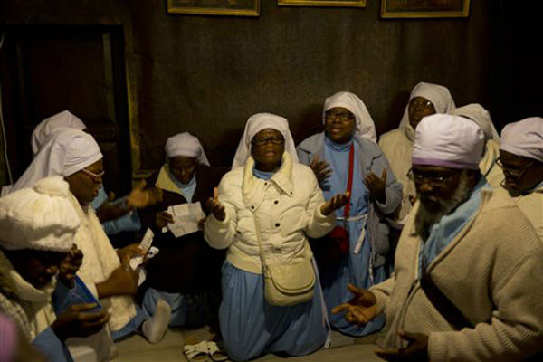 "<div class=""meta image-caption""><div class=""origin-logo origin-image none""><span>none</span></div><span class=""caption-text"">Christian pilgrims from Nigeria pray inside the Grotto of the Church of the Nativity on Christmas Eve, Thursday, Dec. 24, 2015. (AP Photo/ Majdi Mohammed)</span></div>"