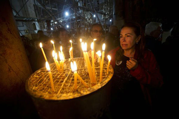 "<div class=""meta image-caption""><div class=""origin-logo origin-image none""><span>none</span></div><span class=""caption-text"">A Christian worshipper lights a candle at the Church of the Nativity, where Christians believe Jesus Christ was born in Bethlehem, Wednesday, Dec. 23, 2015. (AP Photo/ Majdi Mohammed)</span></div>"