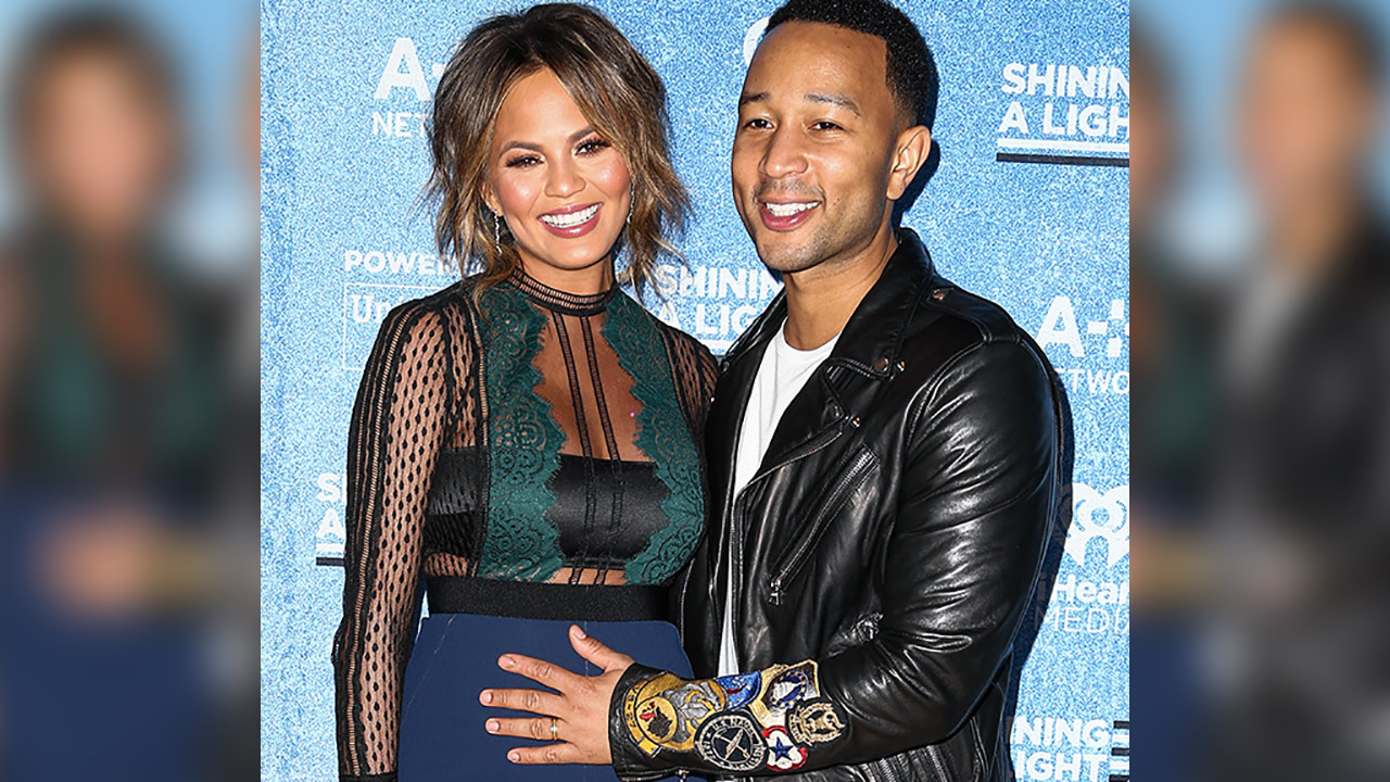 Chrissy Teigen, left, and John Legend pose backstage at the Shining a Light: A Concert for Progress on Race in America held at the Shrine Auditorium on Wednesday, Nov. 18, 2015.