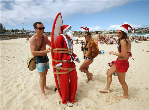 "<div class=""meta image-caption""><div class=""origin-logo origin-image none""><span>none</span></div><span class=""caption-text"">A figure in Santa costume is strapped to a surfboard for easy transport along Bondi Beach in Sydney, Australia. (AP Photo/ Rick Rycroft)</span></div>"