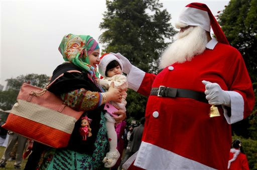 "<div class=""meta image-caption""><div class=""origin-logo origin-image none""><span>none</span></div><span class=""caption-text"">A man dressed as Santa Claus blesses a child at a Christmas party in Dhaka, Bangladesh. (AP Photo/ A.M. Ahad)</span></div>"