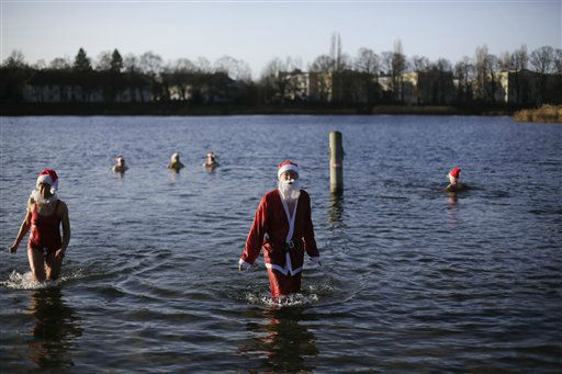 "<div class=""meta image-caption""><div class=""origin-logo origin-image none""><span>none</span></div><span class=""caption-text"">Members of the winter and ice swimming club 'Seehunde Berlin', (Berlin Seals attend the annual Christmas Swimming at the Oranke Lake in Berlin. (AP Photo/ Markus Schreiber)</span></div>"