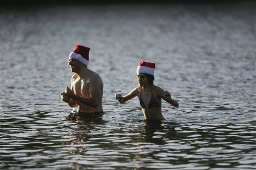 "<div class=""meta image-caption""><div class=""origin-logo origin-image none""><span>none</span></div><span class=""caption-text"">Members of the winter and ice swimming club 'Seehunde Berlin', (Berlin Seals) attend the annual Christmas swim at the Oranke Lake in Berlin. (AP Photo/ Markus Schreiber)</span></div>"
