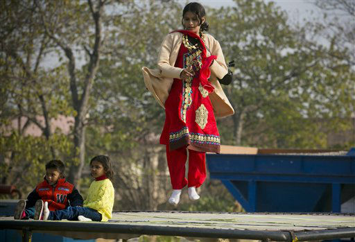 "<div class=""meta image-caption""><div class=""origin-logo origin-image none""><span>none</span></div><span class=""caption-text"">Pakistani Christian girl Maryam Chaudary jumps on a trampoline in a Christian neighborhood for the Christmas holiday in Islamabad, Pakistan. (AP Photo/ B.K. Bangash)</span></div>"