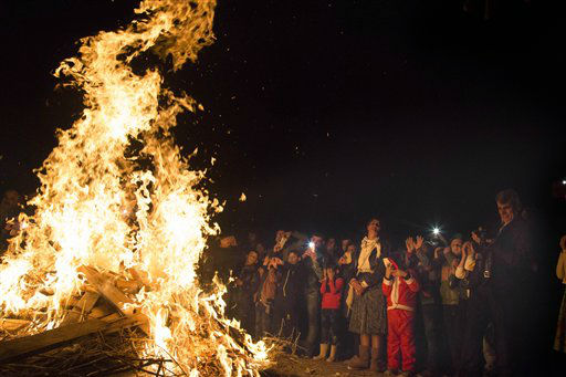 "<div class=""meta image-caption""><div class=""origin-logo origin-image none""><span>none</span></div><span class=""caption-text"">Iraqi Christians gather by a bonfire to celebrate mass in a Christian refugee camp in Irbil, northern Iraq. (AP Photo/ Seivan M. Salim)</span></div>"