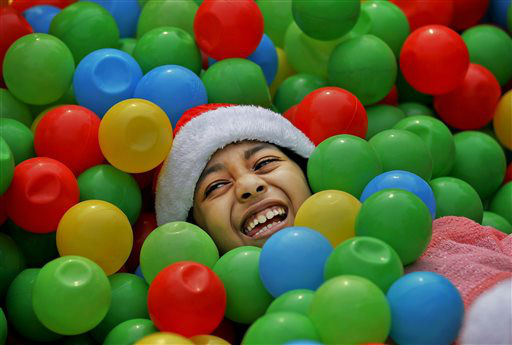 "<div class=""meta image-caption""><div class=""origin-logo origin-image none""><span>none</span></div><span class=""caption-text"">A Bangladeshi Christian girl is all smiles as she plays at a Christmas party in Dhaka, Bangladesh. (AP Photo/ A.M. Ahad)</span></div>"