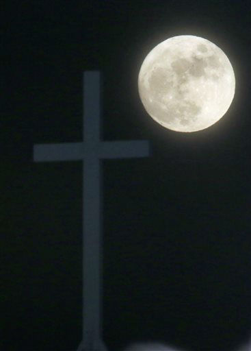 "<div class=""meta image-caption""><div class=""origin-logo origin-image none""><span>none</span></div><span class=""caption-text"">The Long Night Moon rises behind a cross at Christ Community Church in Lawrence, Kan. (AP Photo/ Orlin Wagner)</span></div>"