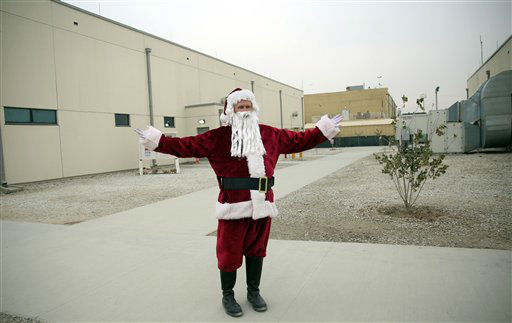 "<div class=""meta image-caption""><div class=""origin-logo origin-image none""><span>none</span></div><span class=""caption-text"">A U.S. soldier dressed up as Santa Claus during Christmas day celebrations at Bagram Air Field, north of Kabul, Afghanistan. (AP Photo/ Massoud Hossaini)</span></div>"