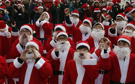 "<div class=""meta image-caption""><div class=""origin-logo origin-image none""><span>none</span></div><span class=""caption-text"">Hundreds of volunteers clad in Santa Claus costumes cheer during a Christmas charity event as they gather to deliver gifts for the poor in downtown Seoul, South Korea. (AP Photo/ Lee Jin-man)</span></div>"