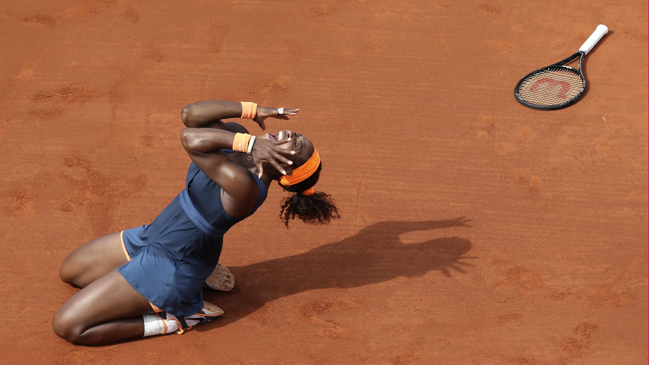 FILE: Serena Williams, of the U.S, celebrates as she defeats Russia's Maria Sharapova in the Women's final of the French Open on Saturday, June 8, 2013 in Paris.