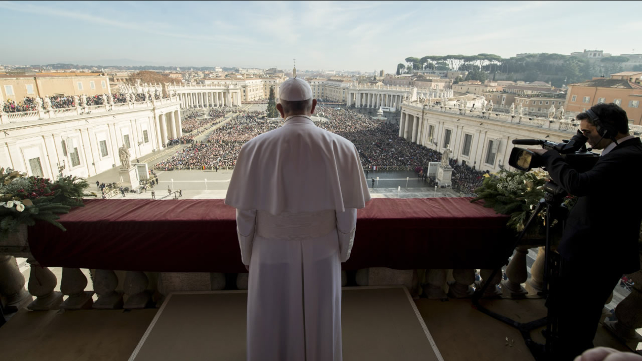 "Pope Francis delivers his ""Urbi et Orbi"" (to the city and to the world) blessing from the central balcony of St. Peter's Basilica at the Vatican, Friday, Dec. 25, 2015."