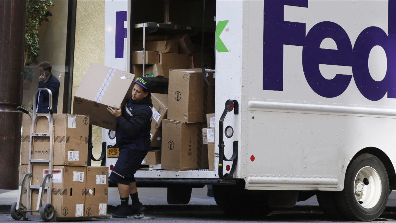 FILE: A FedEx driver loads for a delivery.