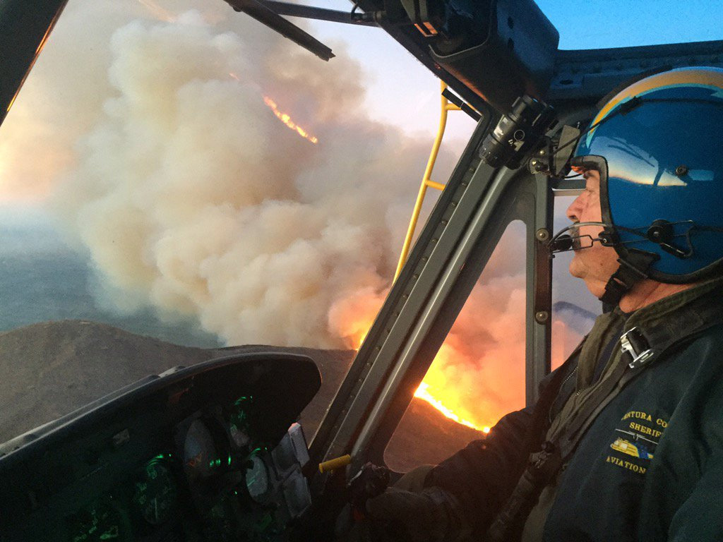 "<div class=""meta image-caption""><div class=""origin-logo origin-image none""><span>none</span></div><span class=""caption-text"">A helicopter pilot works to drop fire on the flames at Solimar Beach on Saturday, Dec. 26, 2015. (twitter.com/VCAirUnit)</span></div>"