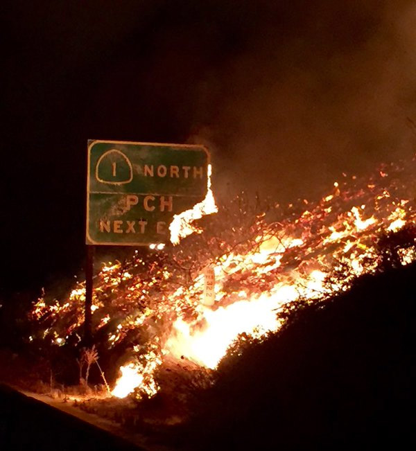 <div class='meta'><div class='origin-logo' data-origin='none'></div><span class='caption-text' data-credit='KABC'>A roadway sign for the Pacific Coast Highway burns in the Solimar Beach fire.</span></div>