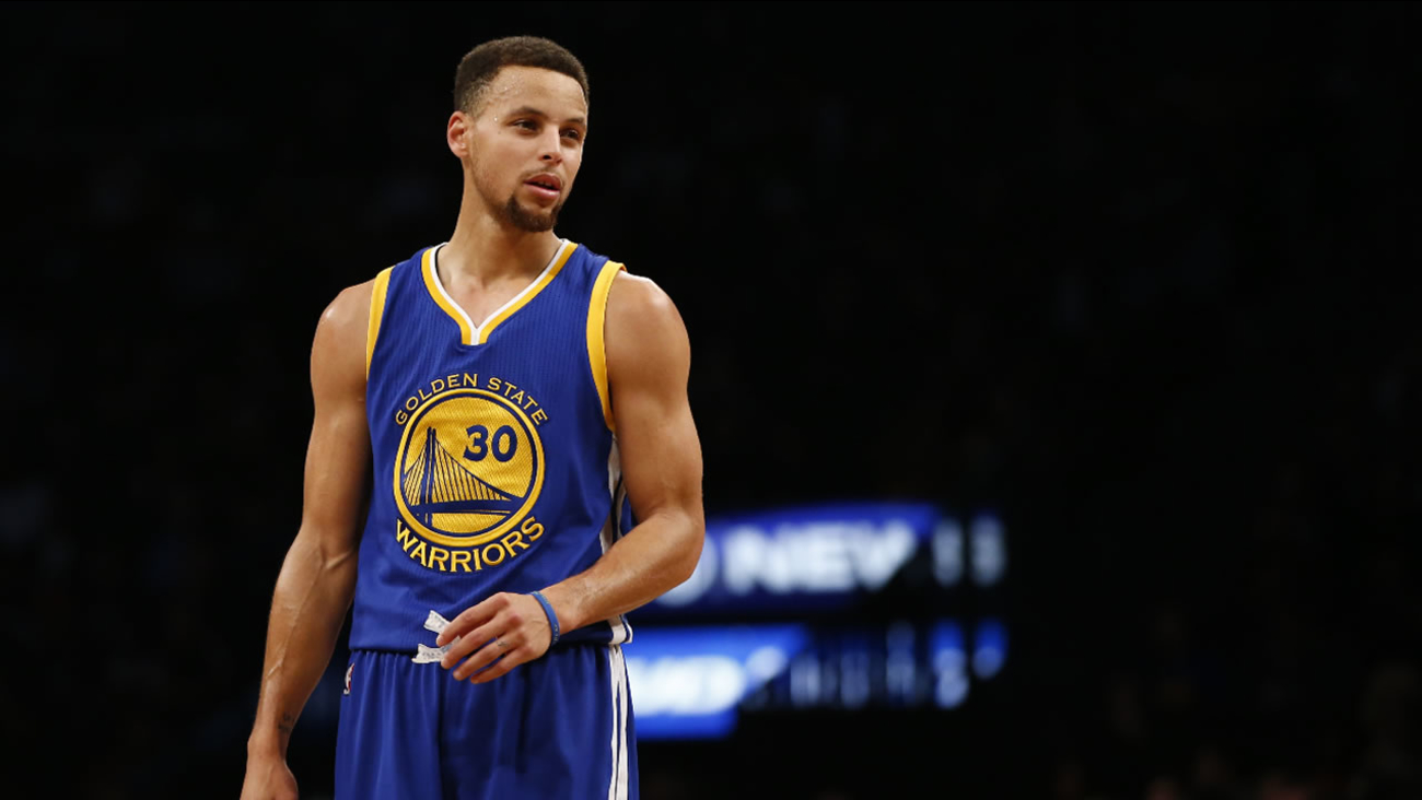 Golden State Warriors guard Stephen Curry (30) stands on the court during a timeout in the first half of an NBA basketball game Brooklyn Nets, Sunday, Dec. 6, 2015, in New York.