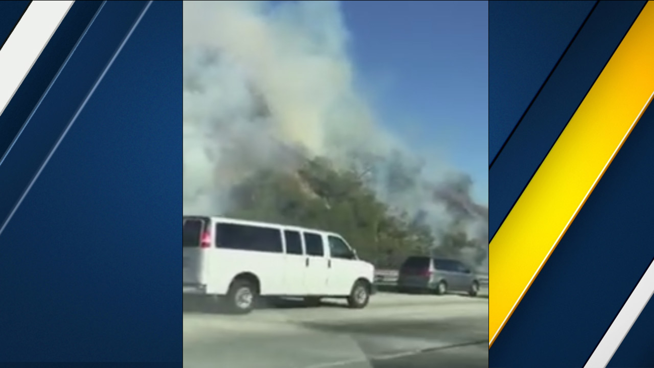 ABC7 viewer Javier Rodriguez captured plumes of smoke coming from a brush fire along the westbound I-10 Freeway in Covina on Saturday, Dec. 26, 2015.
