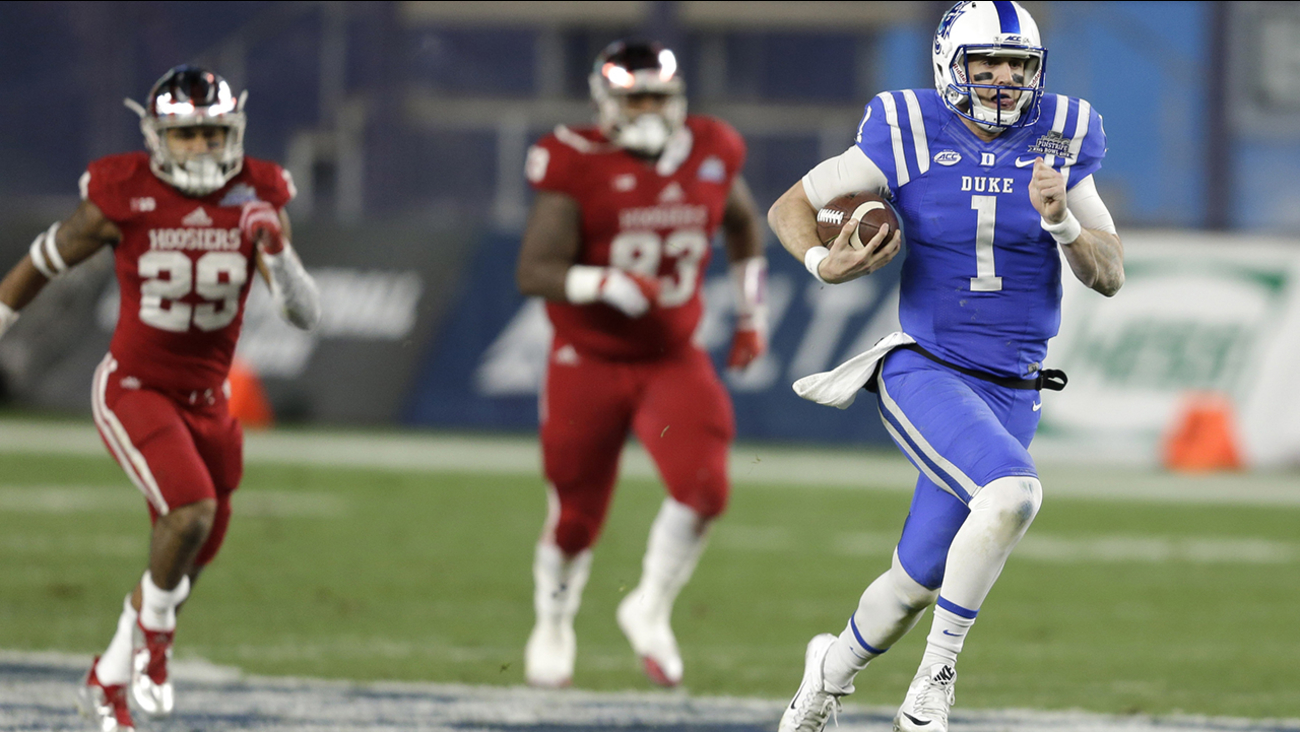 Duke quarterback Thomas Sirk, right, runs the ball for a touchdown during the first half of the Pinstripe Bowl NCAA college football game against Indiana at Yankee Stadium