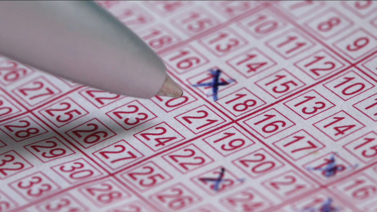A lotto ticket with numbers crossed out by a pen is shown in an undated file photo.