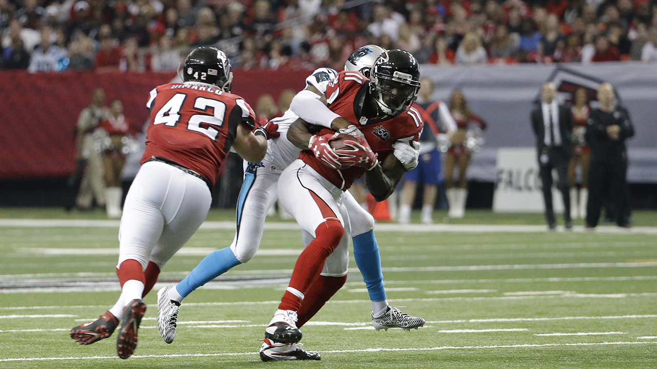 Atlanta Falcons wide receiver Julio Jones (11) makes his fifth catch of the day against Carolina Panthers cornerback Josh Norman (24) during the second half of an NFL football game
