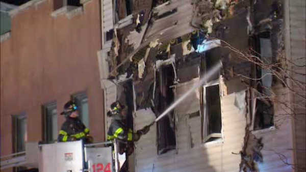 "<div class=""meta image-caption""><div class=""origin-logo origin-image none""><span>none</span></div><span class=""caption-text"">A five-alarm fire tore through an apartment building in Williamsburg, Brooklyn early Monday.</span></div>"