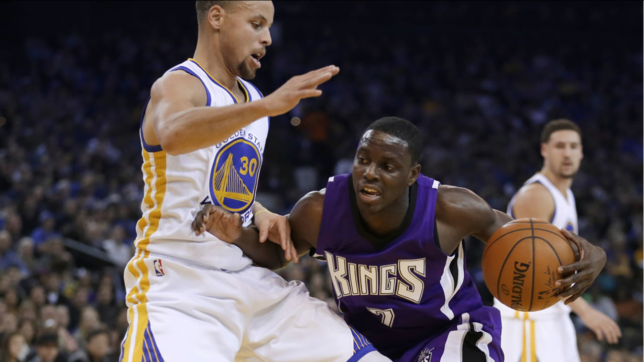 Warriors' Stephen Curry and Kings' Darren Collison