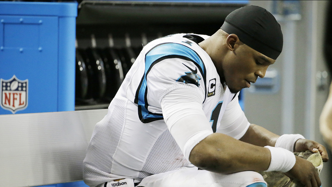 Carolina Panthers quarterback Cam Newton (1) sits on the bench in the closing seconds of the second half of an NFL football game against the Atlanta Falcons, Sunday, Dec. 27, 2015
