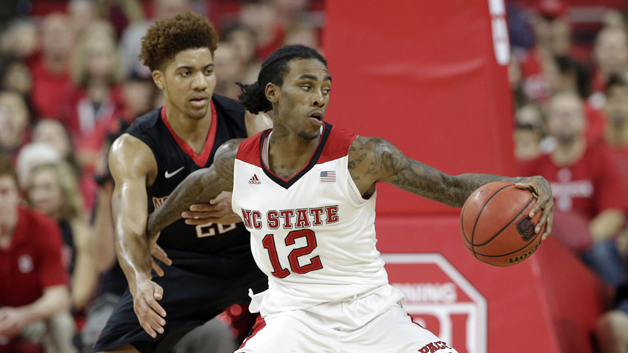 NC State's Anthony Barber (12) is pressured by Northeastern's Donnell Gresham Jr.  on Dec. 29,, 2015. Barber finished with 29 points.